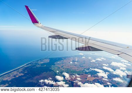 View From An Airplane Window To Polish Coast, Baltic Sea And Puck Bay. Aircraft Flying Over Poland E