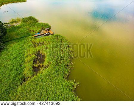 Green Summer Landscape In Europe. Wooden Jetty On Shore Of Lake Kierwik In Masuria Region Poland. Ae