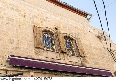 Iron Bars With Iron Shutters On The Windows In An Old Building In The Armenian Quarter Near The Jaff
