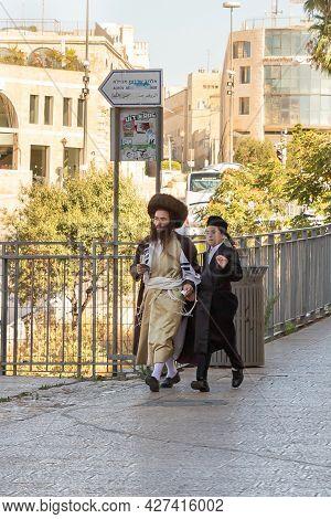 Jerusalem, Israel, July 17, 2021 : Orthodox Jewish Believers - Father And Son Walk Near The Jaffa Ga