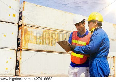 Outdoor Work, Caucasian Engineers And Asian Workers Walk Together In The Area, Inspecting Containers