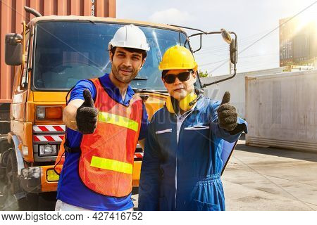 The Caucasian Engineers And Asian Workers Driving The Cargo Truck Partners Work Together In Great Fr