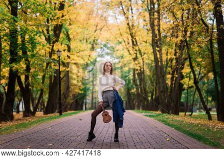 Beautiful Woman Playing Ukulele Guitar At Outdoor In Autumn Forest
