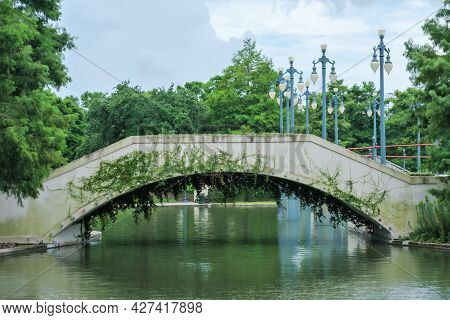 New Orleans, La - July 10: Pedestrian Bridge Over Pond At Louis Armstrong Park On July 10, 2021 In N