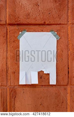 Tear off paper on paint wall. Mock up template. Street paper ad or announcement with tear-off stripes with phone number. Blank design. Copyspace mockup