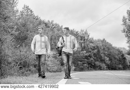 Transporting Issues. Men Backpack Walking Road. Twins Walk Along Road. Brothers Friends Nature Backg