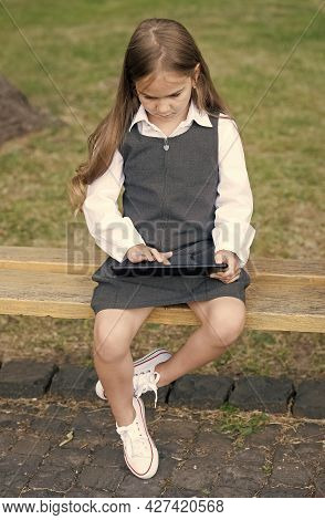 Little Child In School Uniform Touch Screen Or Touchscreen Finger Push Tablet Computer Icon Sitting