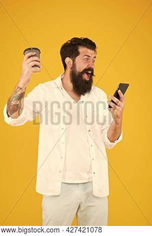 Hipster Reading Message On Smartphone. Mature Bearded Man Chatting On Phone And Drinking Coffee. Mor