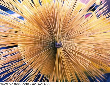 Close Up Of Bristles Of Yellow Nylon Chimney Sweep Brush