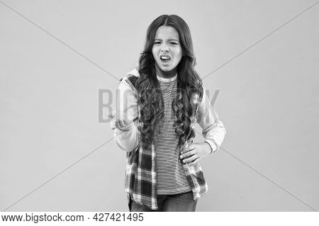Shes Cool And She Knows It. Upset Child Pink Background. Little Girl With Cool Look. Fashion Trends.