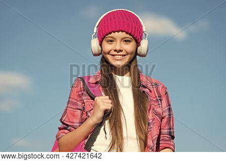 Happy Kid Listen To Music In Modern Headphones Sunny Sky Outdoors, Musical Education