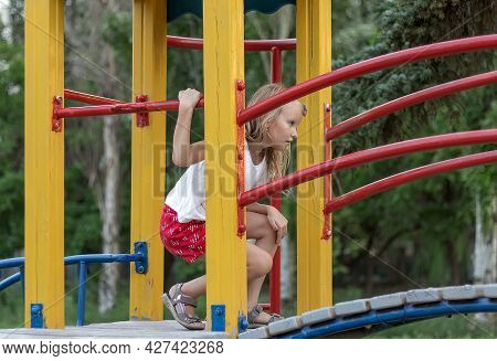 Girl, 6 Years Old, Blonde Plays On The Playground, Portrait Of A Child, Preschooler, Having Fun In T