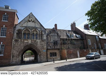Historic Buildings On St Mary's Square Outside Gloucester Cathedral In Gloucester In The Uk, Taken O