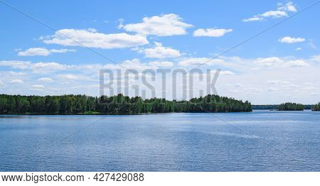 Beautiful Summer Landscape. Bright Blue Sky, White Clouds, Lake, Forest. Most Beautiful Nature Of Th