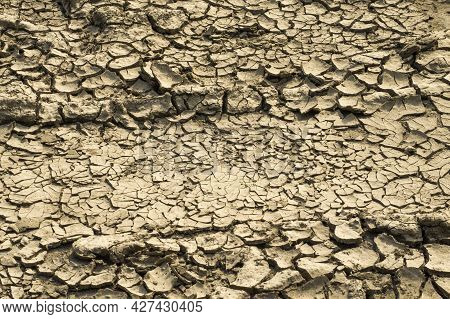 The Texture Of A Cracked Dried Ground Occured After Drought For Use As A Background.
