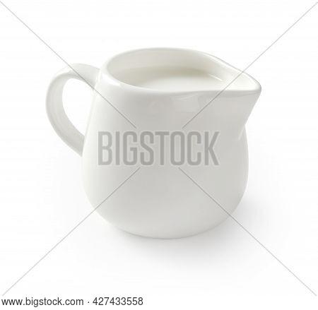 Ceramic Milk Jar Isolated On White Background. Milk Pitcher For Package Design. Porcelain Creamer Pi