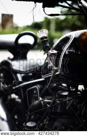 Artistic View Of Glass Crystal Doorknob Motorbike Shifter On Old Antique Motorcycle, With Shallow De