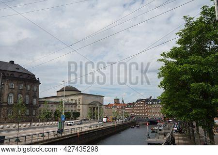 Copenhagen / Denmark - June 13: Waterfront, Canal And Street In Copenhagen, Denmark. Old Facades Of