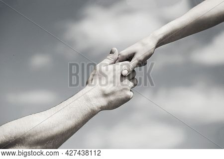 Solidarity, Compassion, And Charity, Rescue. Giving A Helping Hand. Hands Of Man And Woman On Blue S