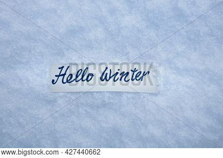 Marker Inscription Hello Winter On  A Of White Fluffy Snow  Background, Snow Texture Background
