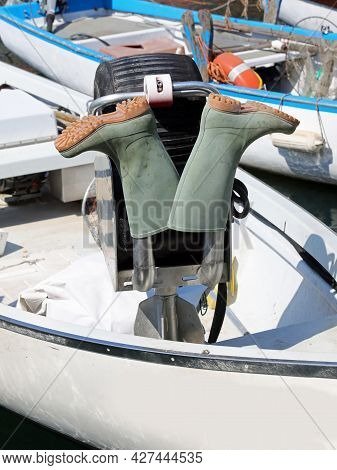 Two Fisherman S Green Rubber Boots Drying On The Boat After Night Fishing Off The Sea