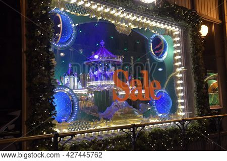 Russia, St. Petersburg 08.03.2021 Signboard About A Sale In A Shop Window With Illumination In The E