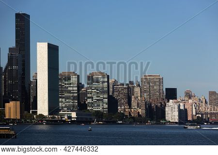 Manhattan, New York City. United Nations Headquarters. View From The East River. Skyscrapers Of Manh