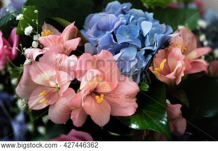 Festive Bouquet Of Assorted Flowers Including Blue Hydrangea And Pink Alstroemeria