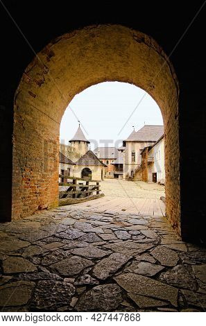 Scenic Landscape View Of Inner Yard With Ancient Stone Buildings In Medieval Castle. Stone Border. N