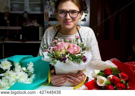 Smiling Florist Woman With Three Different Bouquets Of Flowers. Portrait Of Young Female Florist Wit