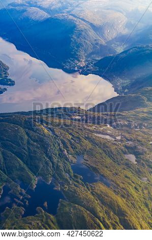 View From Airplane To Norwegian Fjords Landscape. Aircraft Flying Over Norway Scandinavia.