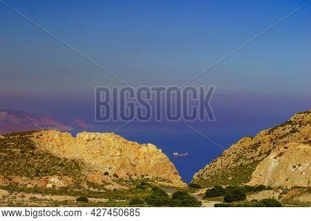 Rocky Coastal Landscape With Ship On Sea. View From Mesa Roldan. Cabo De Gata Nijar, Coast Almeria,