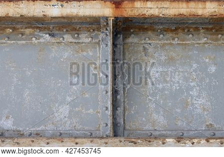 Old Worn Metal Sheets Fastened With Rivets.