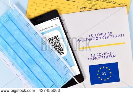 Dossenheim, Germany - July 2021: Eu Covid-19 Vaccination Certificate On Paper And Digital On Mobile