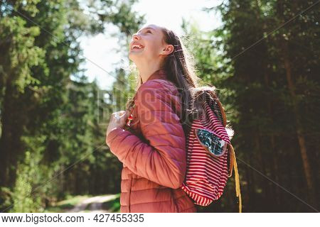 Pretty One Teen Young Tourist Girl Relaxing On Forests Road.teenage With Backpack On Green Forest Su
