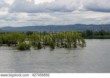 High Water Rising In Yenisey River Under Cloudy Grey Sky In Krasnoyarsk, Russia. City Under Water Du