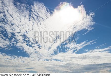 Blue Sky With White And Colorful Iridescent Clouds. Heaven Concept Background