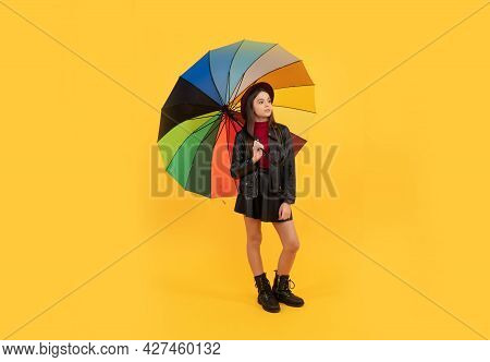Cheerful Teen Child Hold Colorful Parasol. Kid In Hat With Rainbow Umbrella.