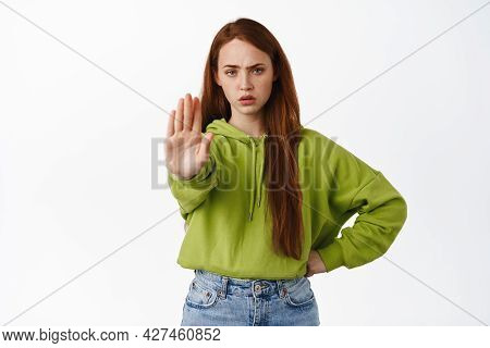 Stop. Angry Ginger Girl Stretch Hand To Prohibit, Reject And Disapprove, Decline Something, Say No,
