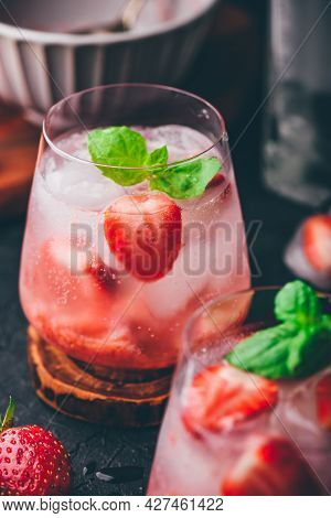 Two Glasses Of Cocktail With Fresh And Frozen Strawberry, Gin And Tonic