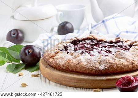 Traditional French Pastries Open Pie Or Galette With Red Plums. Concept Of Summer Home Baking.