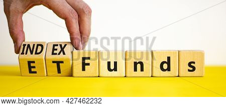 Index Funds Vs Etf Symbol. Businessman Turns A Cube And Changes Words 'etf, Exchange-traded Fund' To