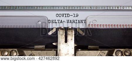 Covid-19 Delta Plus Virus Variant Symbol. Words 'covid-19 Delta Plus Variant' Typed On Retro Typewri