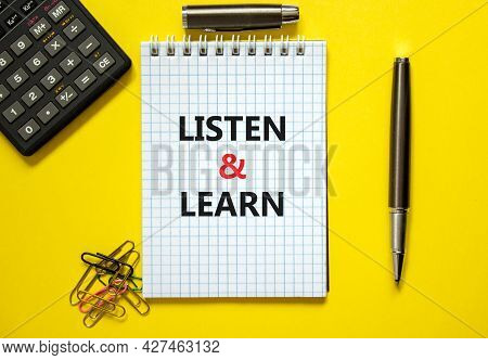 Listen And Learn Symbol. Words 'listen And Learn' On White Note. Yellow Background, Paper Clips, Met