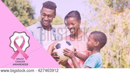 Composition of october and breast cancer text, with smiling family outdoors. breast cancer positive awareness campaign concept digitally generated image.