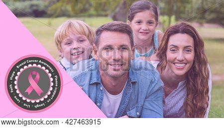 Composition of pink ribbon logo and breast cancer text, with smiling family outdoors. breast cancer positive awareness campaign concept digitally generated image.