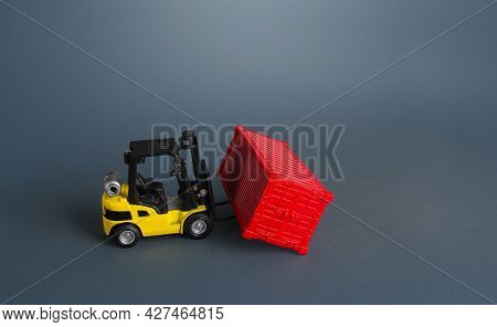 Forklift And Red Container. Effective Organization Of Goods Storage In A Warehouse. Warehousing Conc