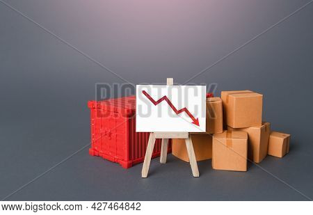 Boxes And Container Near The Easel With A Red Down Arrow. Drop Of Goods Transportation Volume, World