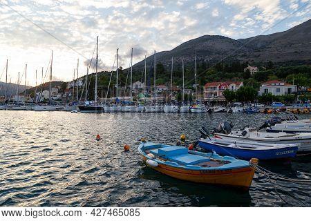 Agia Efimia, Cephalonia Island, Greece - July, 12 2019: Small Fishing Boats And White Yachts Anchore