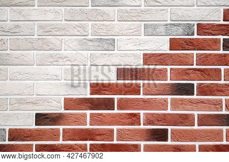 Decorative Brickwork Background Of Red And White Bricks Laid Out Diagonally.